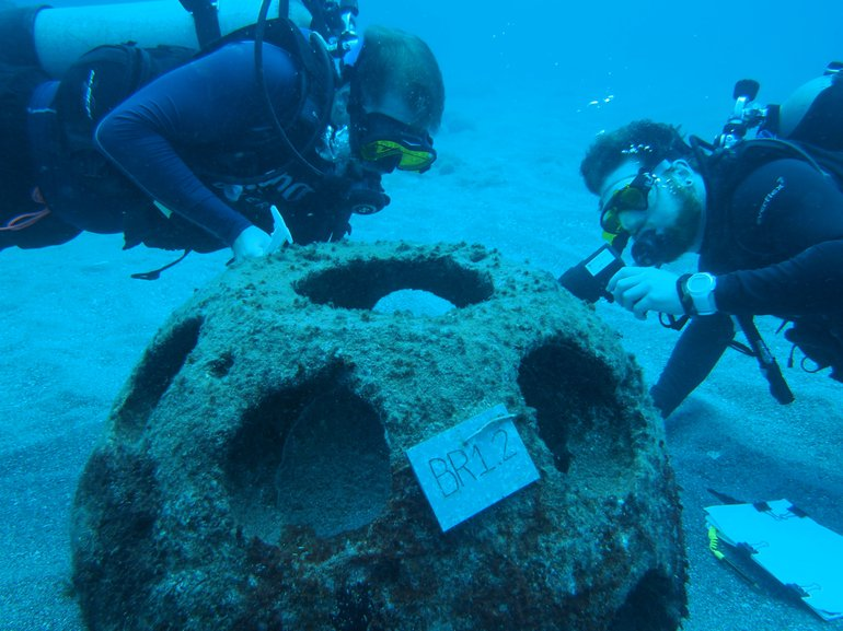 Researchers counting coral recruits on a reef ball