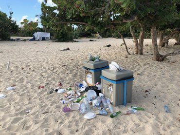 Trash around bins at the beach, St. Maarten